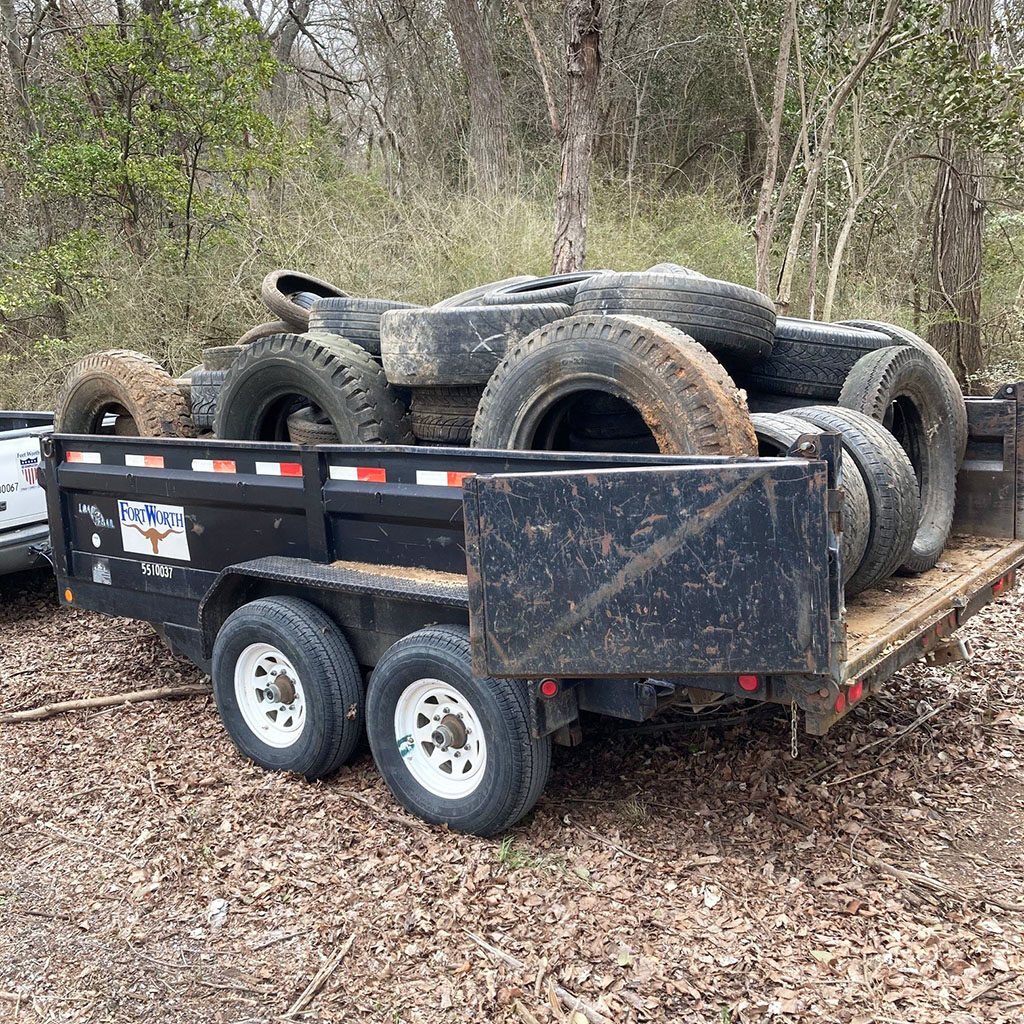 Trailer full of old tires ready to be hauled away at the Fort Worth Nature Center