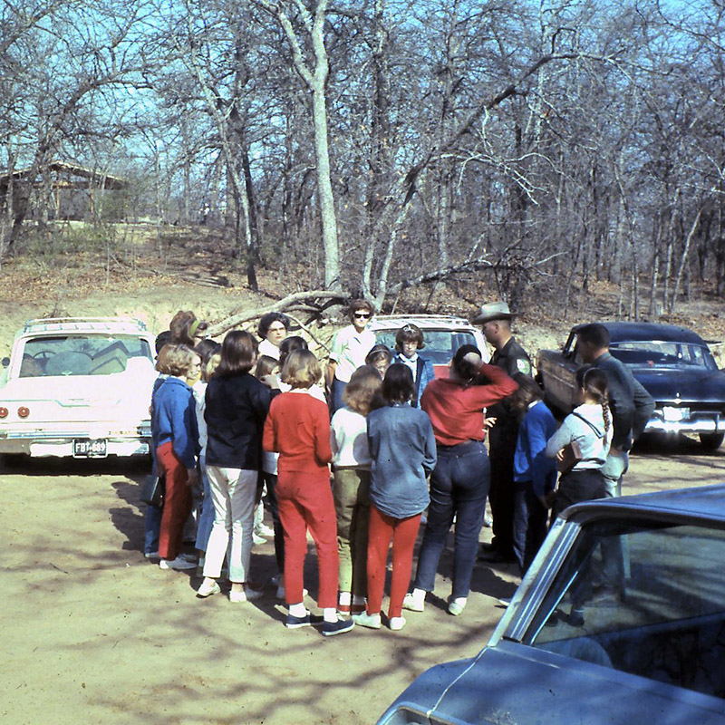 Old 1960s photo of a staff member giving a tour from a parking lot at Greer Island at the Fort Worth Nature Center