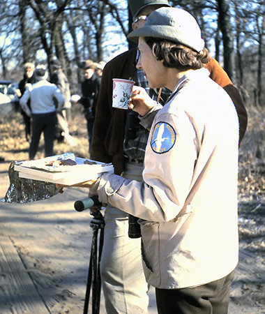 Old 1964 photo of Margaret Parker drinking coffee during an Audubon field trip to Greer Island at the Fort Worth Nature Center