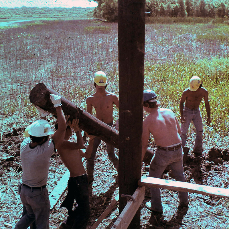 Old 1980 photo of young men constructing the original Boardwalk at the Fort Worth Nature Center