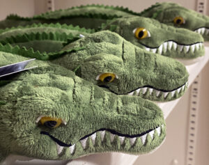Display of green stuffed alligators at the Friends Gift Shop at the Fort Worth Nature Center