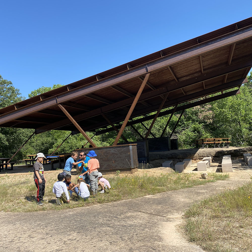 Michael Perez teaching young campers about nature during Summer Natural History Adventures at the Lotus Marsh Pavilion at the Fort Worth Nature Center