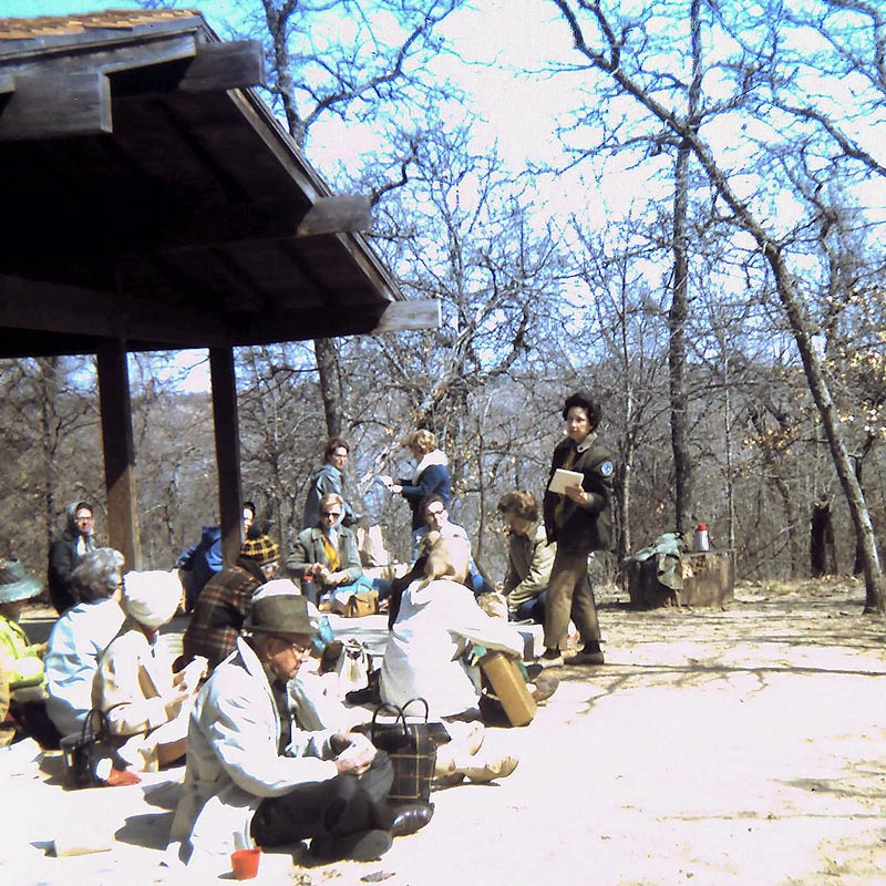 Old 1960s photo of a staff member giving a tour at Greer Island at the Fort Worth Nature Center