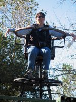 Suzanne Tuttle in elevated seating overseeing bison handling at the Fort Worth Nature Center